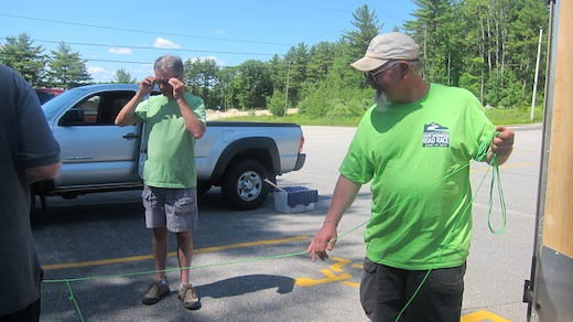 Ed O'Hearn, N1EO adjusting his glasses while Dave Megin, KA1VJU pulls on parachute cord for an antenna lift.