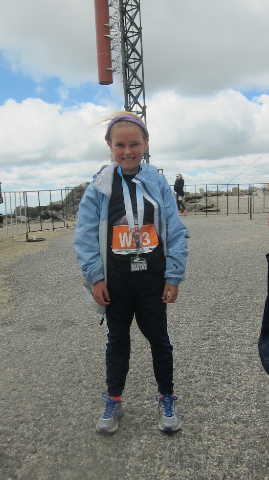 Katie Loomis-Adams proudly displays her medal for completing the 7.6 miles up Mt. Washington. Congrats Katie! Photo credit: Tim Carter, 2013