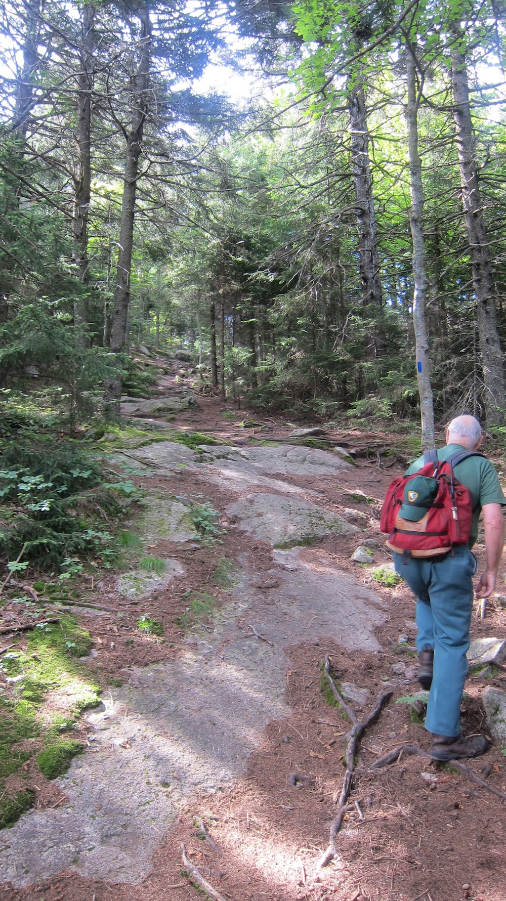 Hal Graham leading the way up the Blue Trail to the summit of Belknap Mountain. Note the exposed bedrock.
