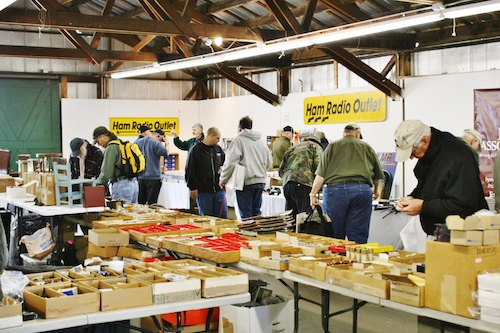This is the typical scene inside the covered buildings at NEARfest. The secret Yaesu booth was just to the right. Photo credit: Glen Aldrich, KC1AAI