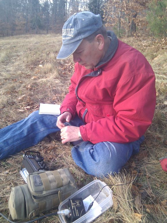 Here's Jim operating a tiny iambic paddle to send the characteristic di's and dah's that are part of a CW signal. Photo credit: Tim Carter, W3ATB