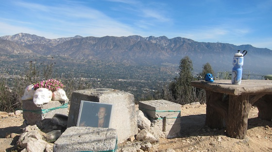 Here's the summit. It's a small knob next to a large flat area. The concrete monument holds the actual USGS bronze benchmark. A shrine was also on the summit. More on that in the story. Photo credit: Tim Carter, W3ATB