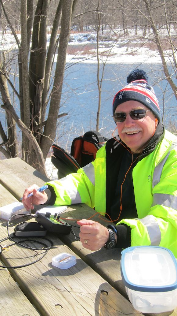 That's me! I've got a smile on my face because of the weather, the company and I just completed my first outdoor QSO next to the Pemi! Photo credit: Jim Cluett, W1PID