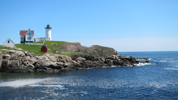 This is the famous Nubble Lighthouse in Maine. You're 2/3rds of the way to Ongunquit, ME from Portsmouth, NH when you stop here for water. This photo was taken in May, 2012. In 2014, the fog was so thick you could barely see the lighthouse from shore. Photo credit: Tim Carter - W3ATB