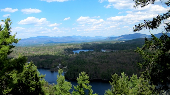 This is a view looking north northeast from the end of the Bald Ledge trail above Sky Pond, NH. Lake Winona is in the foreground and you're looking out at the Squam Mountain range with Mt. Morgan the highest peak towards the left. Photo credit: Tim Carter - W3ATB