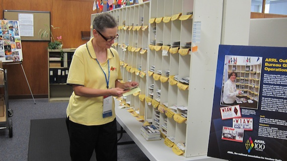 An ARRL staff member sorting traditional paper QSL cards to be sent to ham operators in the USA and around the world. Photo credit: Tim Carter - W3ATB