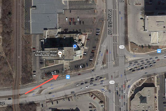 The red arrow points to where I was set up. It was a very steep small section of grass between the hotel parking lot and the busy street.