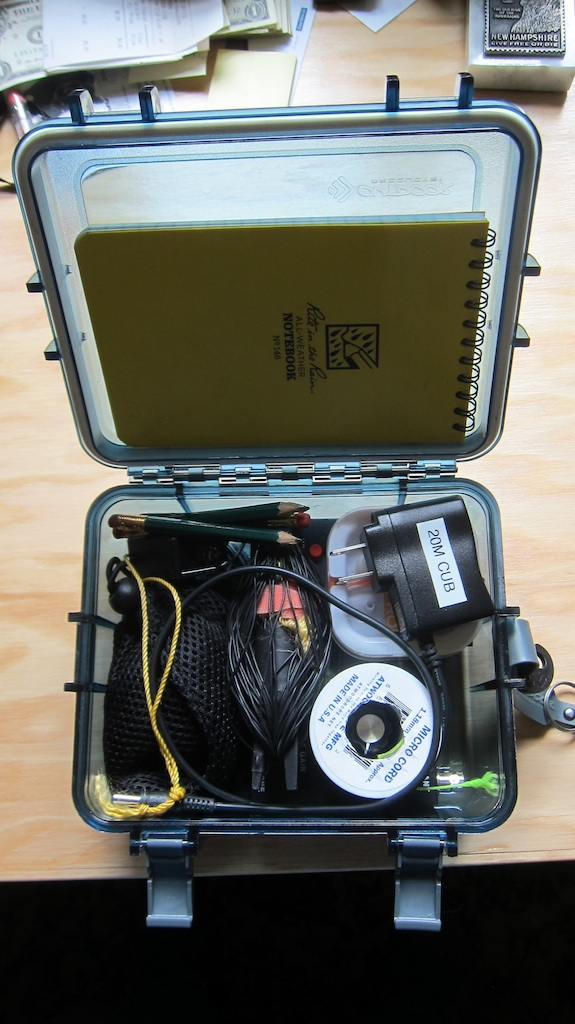 Everything is in this box. The HB-1B is buried down under everything else. The only thing I need to operate is a rock to help get the green microcord halyard up into a tree. I partially filled water bottle is my weapon of choice.