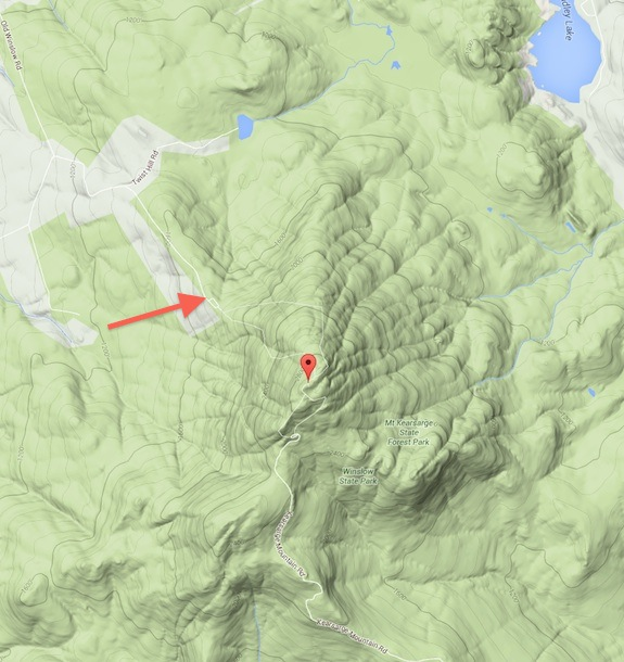 The tip of the red arrow points to a rare flat spot on the flank of Mt. Kearsarge. The view to the west, north and east is dramatic. Image credit: Google Maps