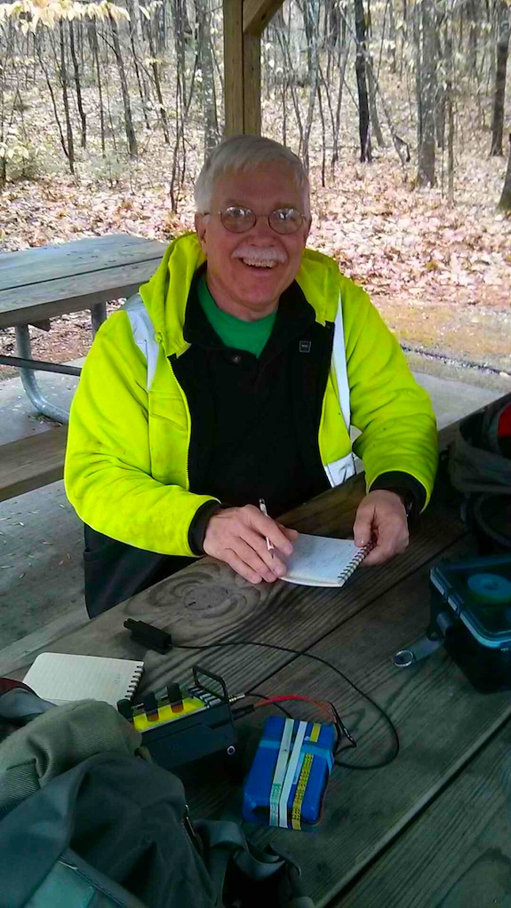 Here I am happy to be using an Elecraft KX3 and staying warm with our Little Buddy heater under the table. Photo credit: Jim Cluett