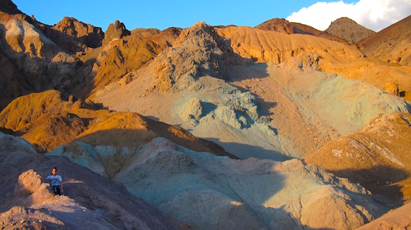 Here's some rocks colored by volcanic activity and enhanced by the setting sun. I took this photo in the magic hour before sunset at the Artist's Palette loop road south of Furnace Creek. Photo credit: Tim Carter - W3ATB