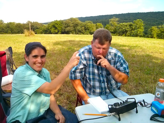 Emily is applying massive amounts of high-energy RF spray so her husband Keith Comp gets the needed ten contacts to officially activate the Appalachian Trail. Photo credit: Tim Carter - W3ATB