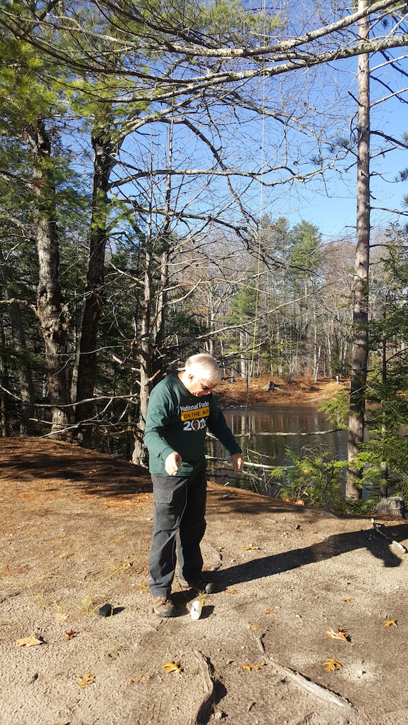 Moments before I launched my water bottle up into the tree about 40 feet. Now I'm attaching my 29-foot wire antenna to the lanyard to pull it up. A 9:1 unun is attached to the bottom of the wire. (C) Copyright 2016 Nick Mollo